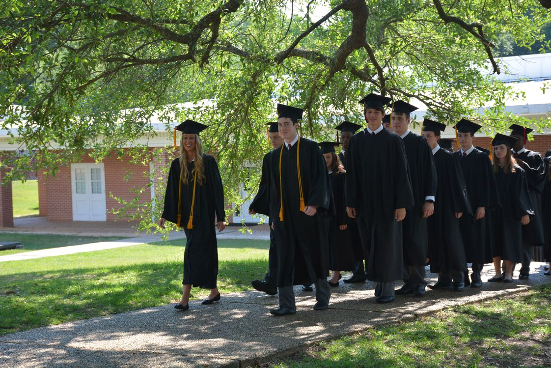 St. Luke's Episcopal School Photo - St. Luke's seniors parade the campus one last time before their commencement ceremony.