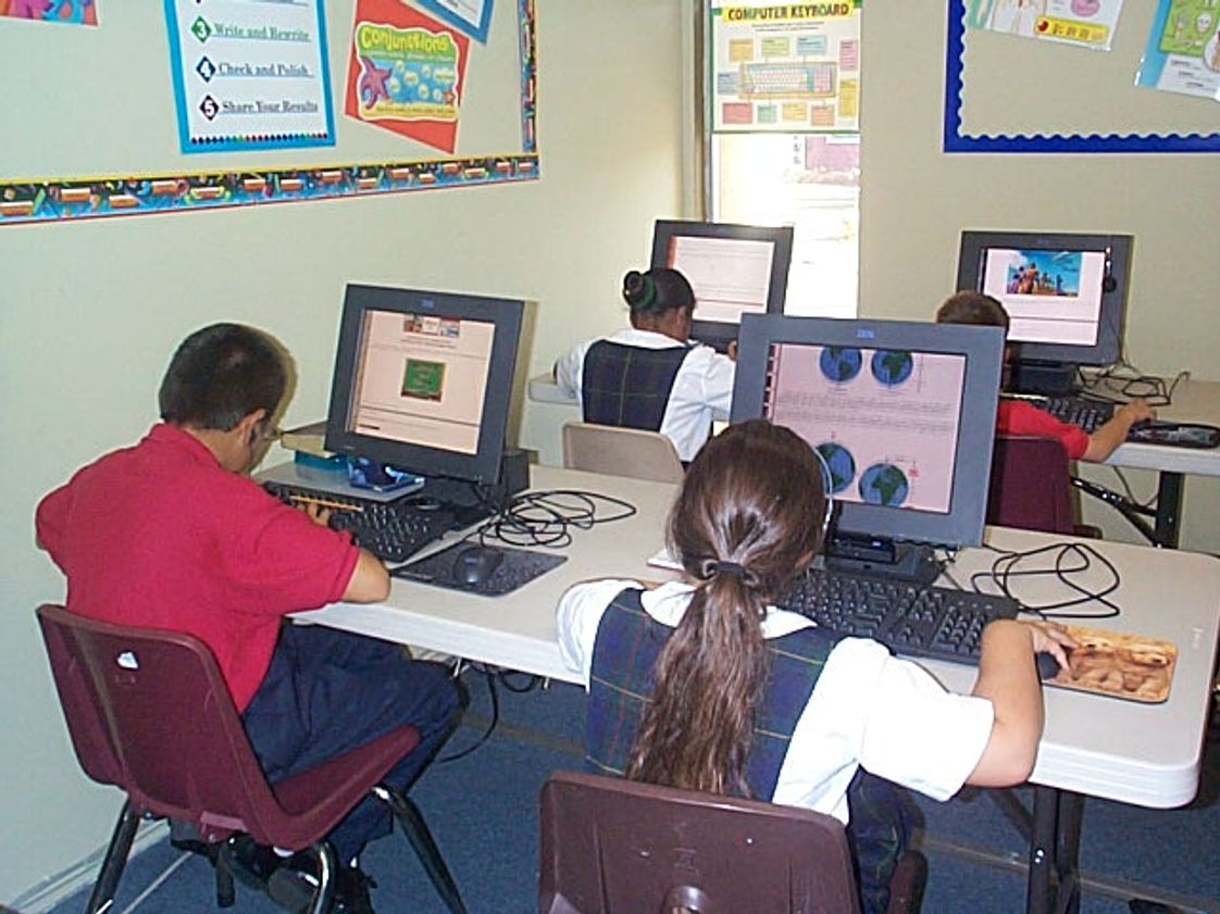 South Bay Christian Academy Photo - Students working on computers in the Elementary classroom