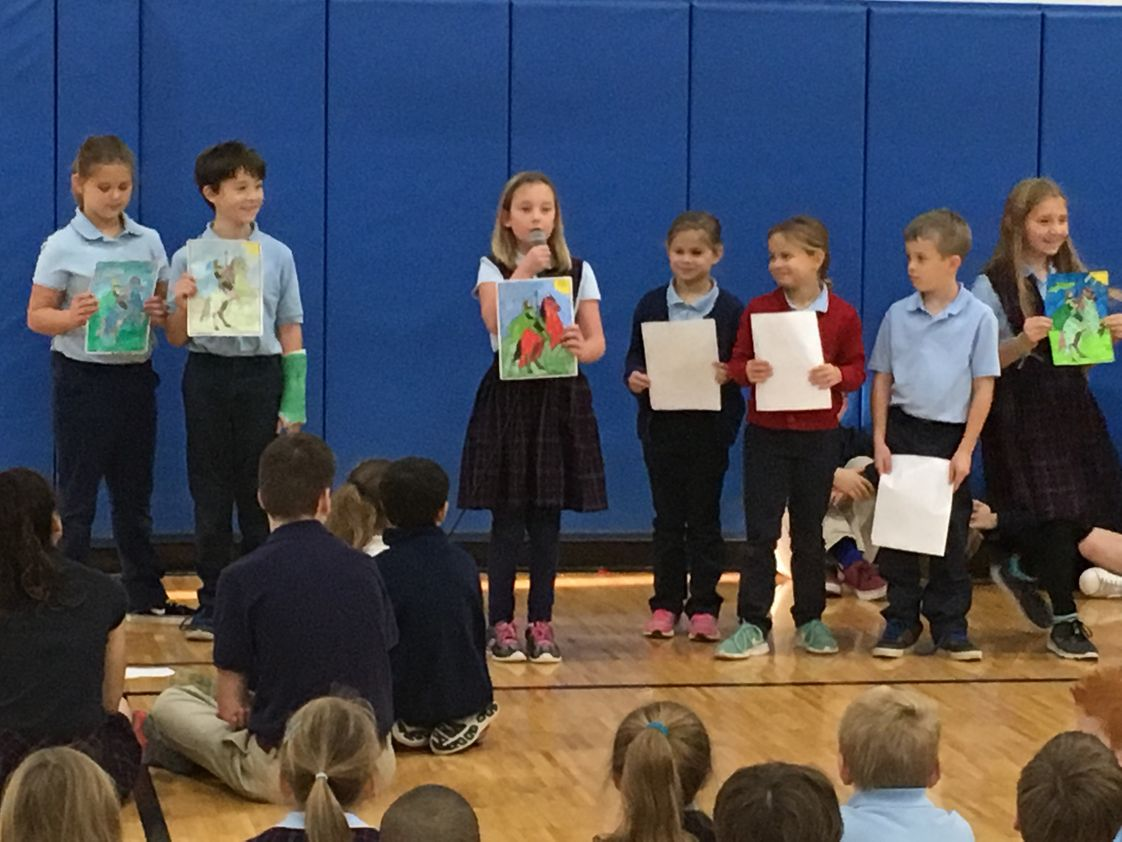 St. Mary Catholic School Photo - Third Grade presented about Joan of Arc during Morning Prayer.