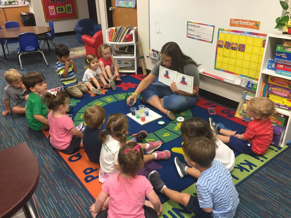 "Rohan Woods School Photo #1 - Our Early Childhood class (Age 2) watches as Ms. Sullivan creates the colors in the book they are reading-- MOUSE PAINT. ""It was magic, one little kiddo said as red and blue made purple!"""