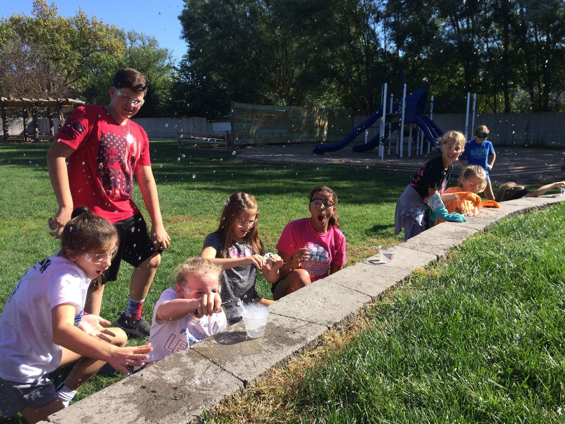 St John Lutheran School Photo #1 - St. John's 6th-grade dry ice science experiment in front of the outdoor classroom.