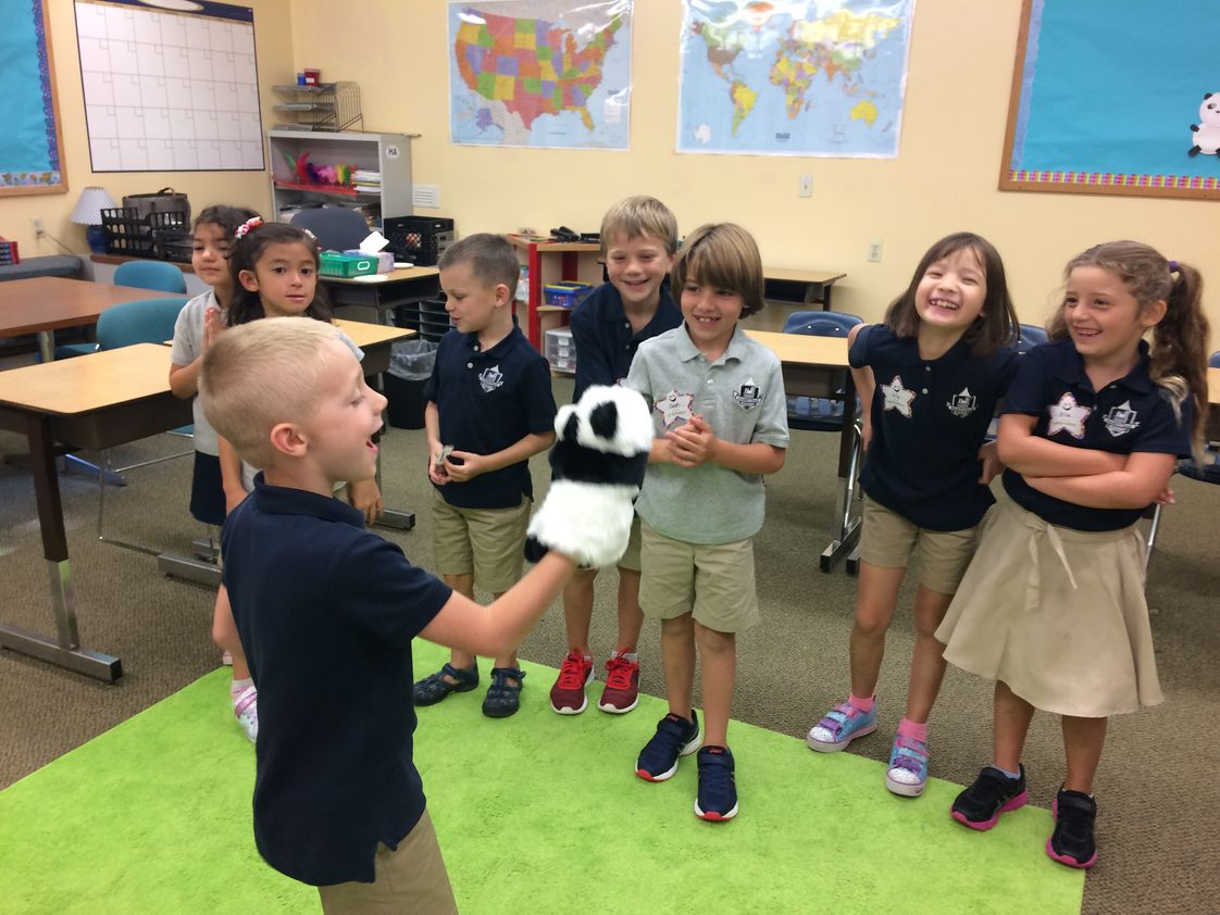 Hampstead Academy Photo - Students begin learning Spanish and Chinese in Pre-Kindergarten and elementary grades through song, fingerplays, and fun activities like puppet shows.