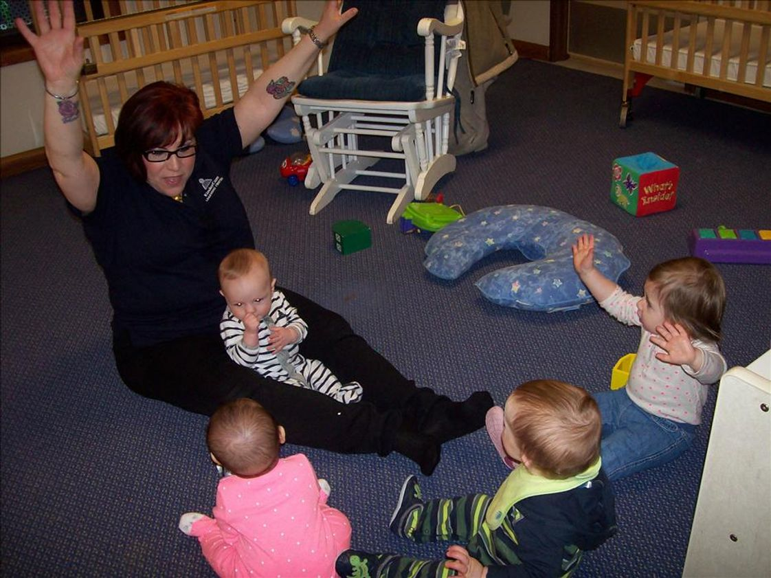 Springdale Road KinderCare Photo #1 - Ms. Lisa doing circle time with the infants.