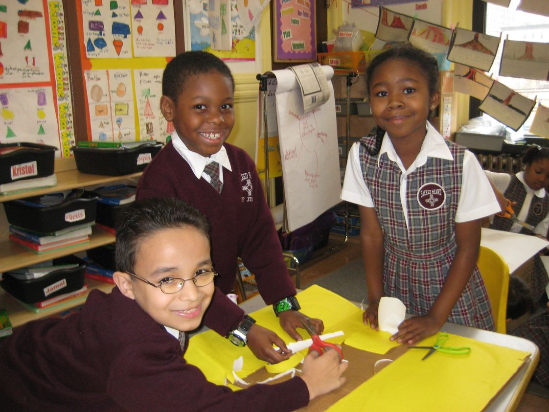Sacred Heart Of Jesus School Photo #1 - Students work together to solve problems and create solutions. Collaboration is the foundation to learning and success.
