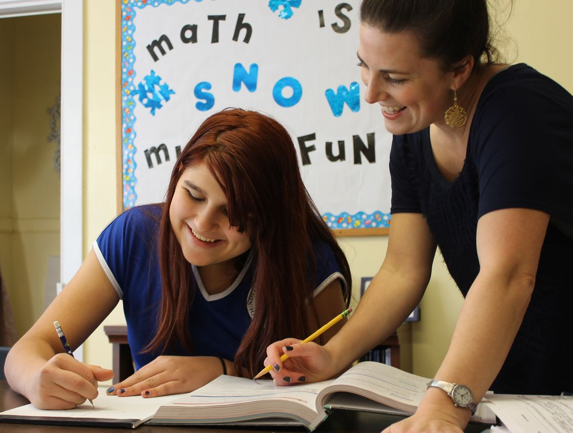 Soundview Preparatory School Photo #1 - A teacher working with a student in math class