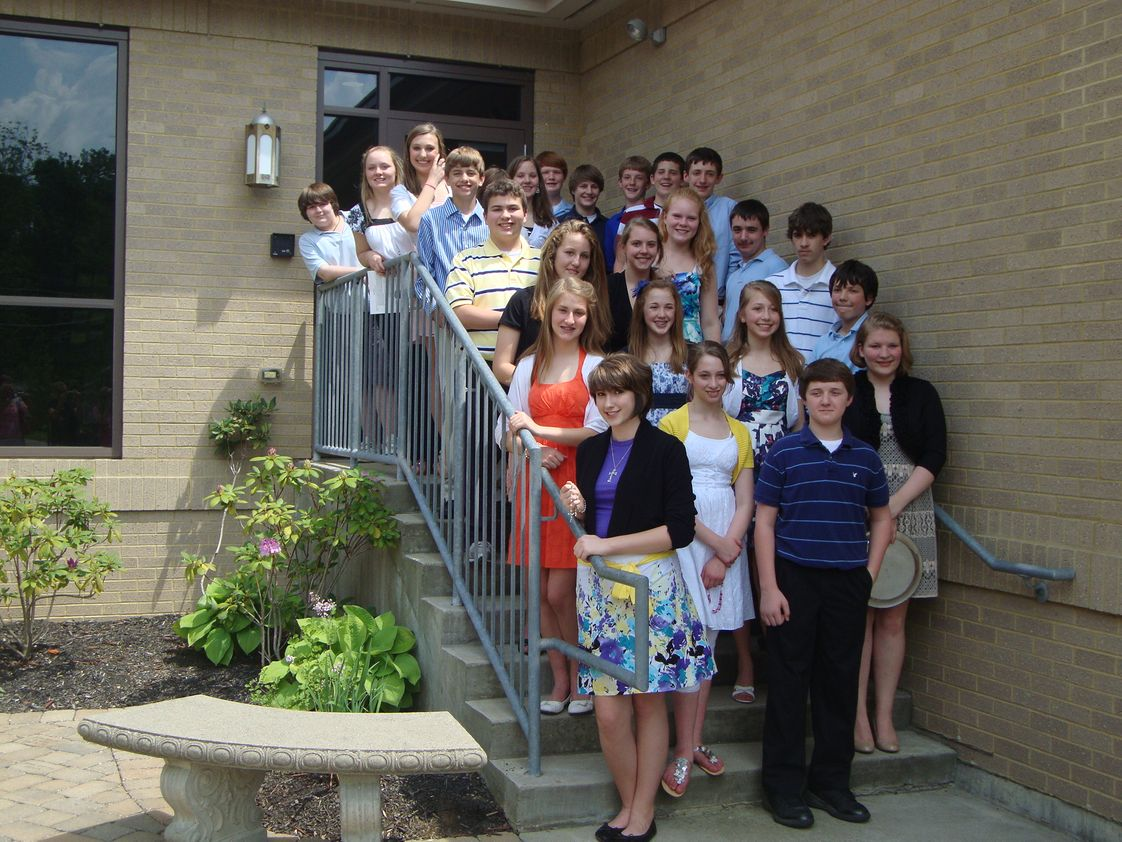 St. Louis School Photo - Eighth grade leadership during the annual school May Crowning Ceremony has special meaning for our students.