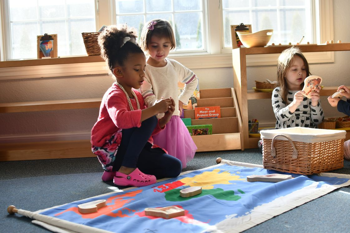 West Side Montessori Photo - Children spend up to three years with the same teachers. Mixed-age groups encourage interaction between older and younger children; older children become role models for younger children. Children encouraged to teach, help, and collaborate with one another.