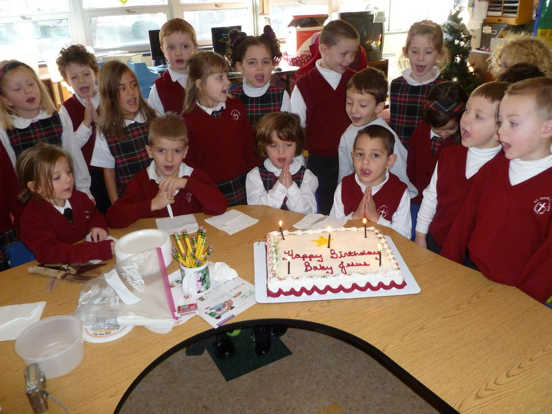 St. Rose Of Lima School Photo #1 - The St. Rose of Lima School Kindergarten celebrated the birthday of baby Jesus with a special cake and song.