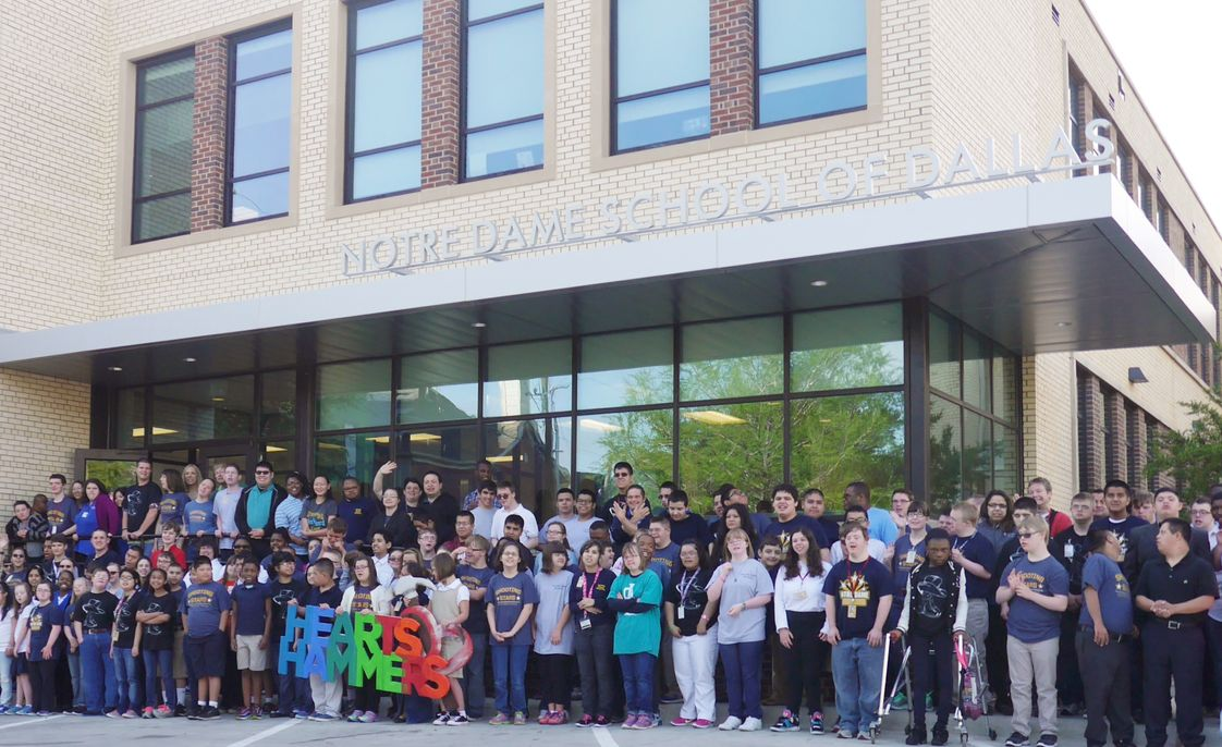 Notre Dame School Photo - Celebrating the completion the donors of our Hearts & Hammers campaign.
