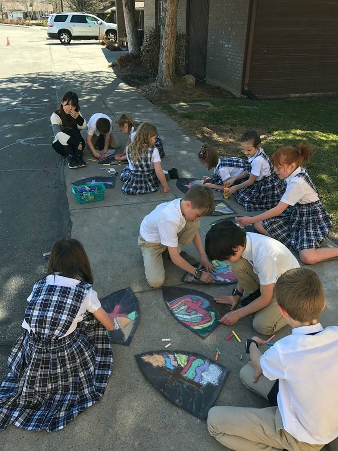 Grace Lutheran School Photo - Students draw their stained glass artwork outside on a balmy fall day. Fine arts are heavily emphasized classwork at Grace, students compete in state sponsored art shows and present their works in our annual Grace Lutheran Open House Art Exhibitions.