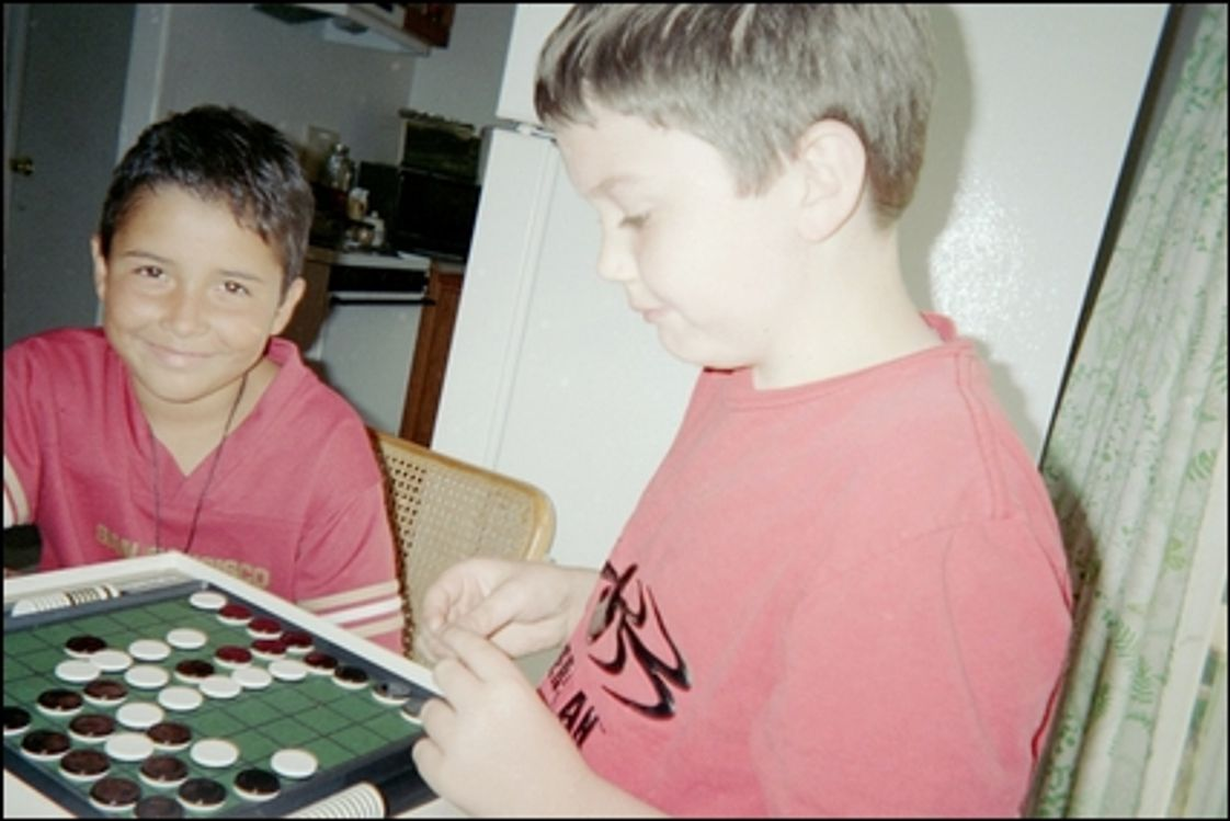 Wherry Academy Photo #1 - After studying their English, math, history, science and French, John and Andy relax with a game.