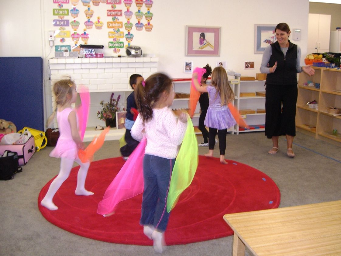 Step By Step Montessori School Photo #1 - Miss Michelle a member of Kinder Cance Academy (CDA) is teaching 3-6 years old children