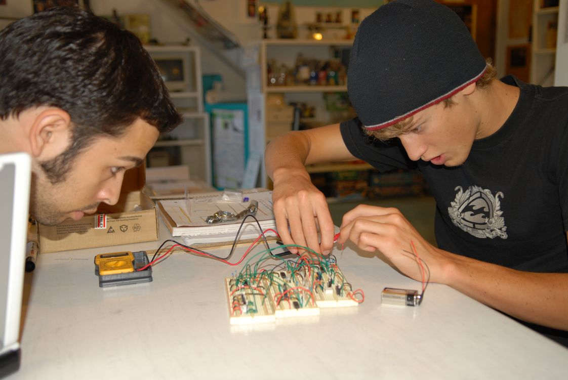 Merit Academy Photo #1 - Engineering a brake-light system. All students engage in ProjectMERIT where they start an independent project that teaches them leadership and critical thinking skills in the real world. These projects separate Merit Academy students from their peers in the competitive college admissions process.