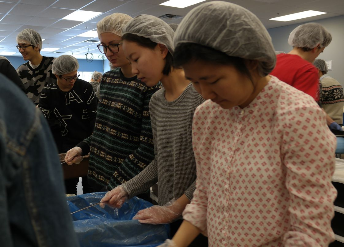 St Paul Preparatory School Photo #1 - SPP seniors have a service learning requirement to fulfill for graduation. Here they are volunteering at Feed My Starving Children.