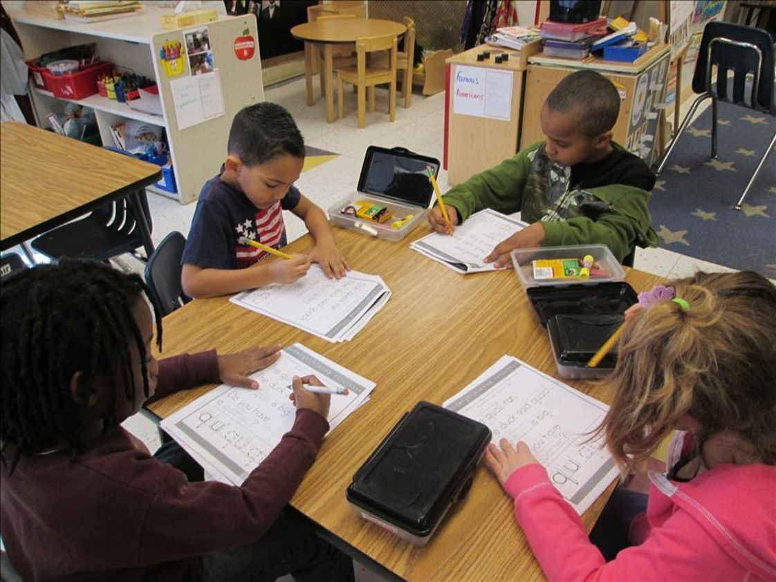 East Weymouth KinderCare Photo - Vincent, Kise, Clover and Travis working hard in Kindergarten.