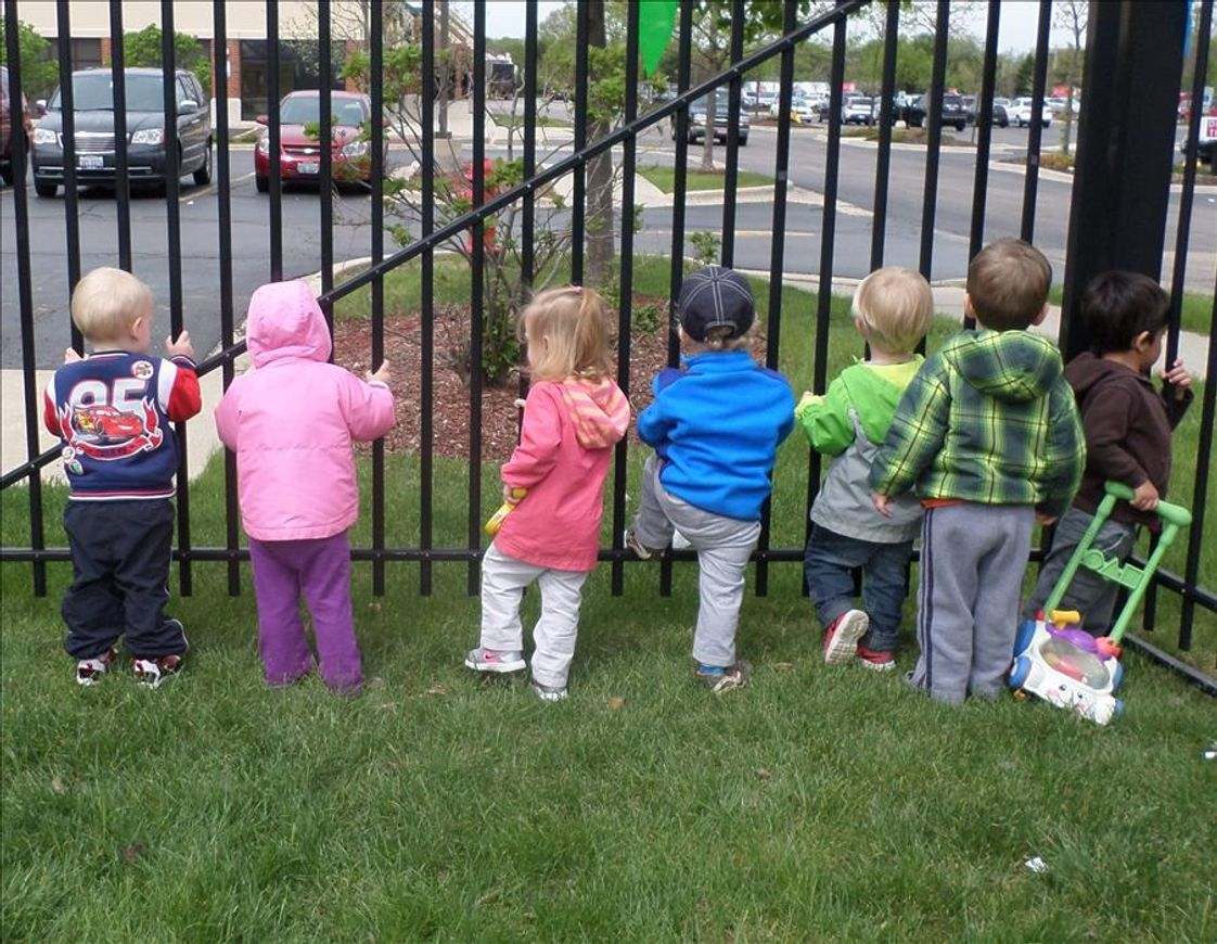 Hoffman Estates KinderCare Photo #1 - The playground is a great place to explore and play and sometimes we see really cool things like garbage trucks, school busses and more things that pass by!