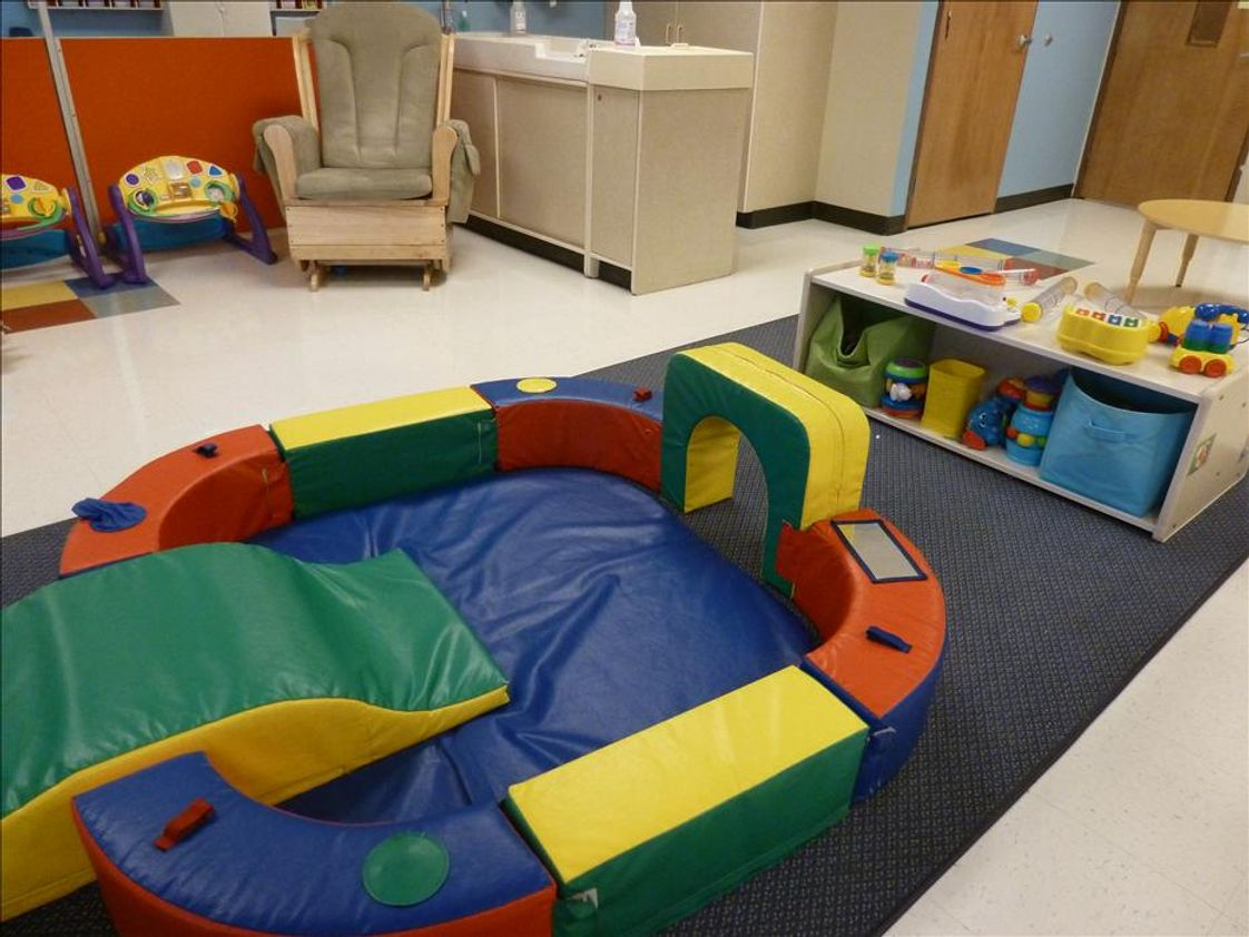 Florence KinderCare Photo #1 - Our infant classroom is all theirs to explore. We provide a least restrictive atmosphere which allows the infants to roam and explore their space.