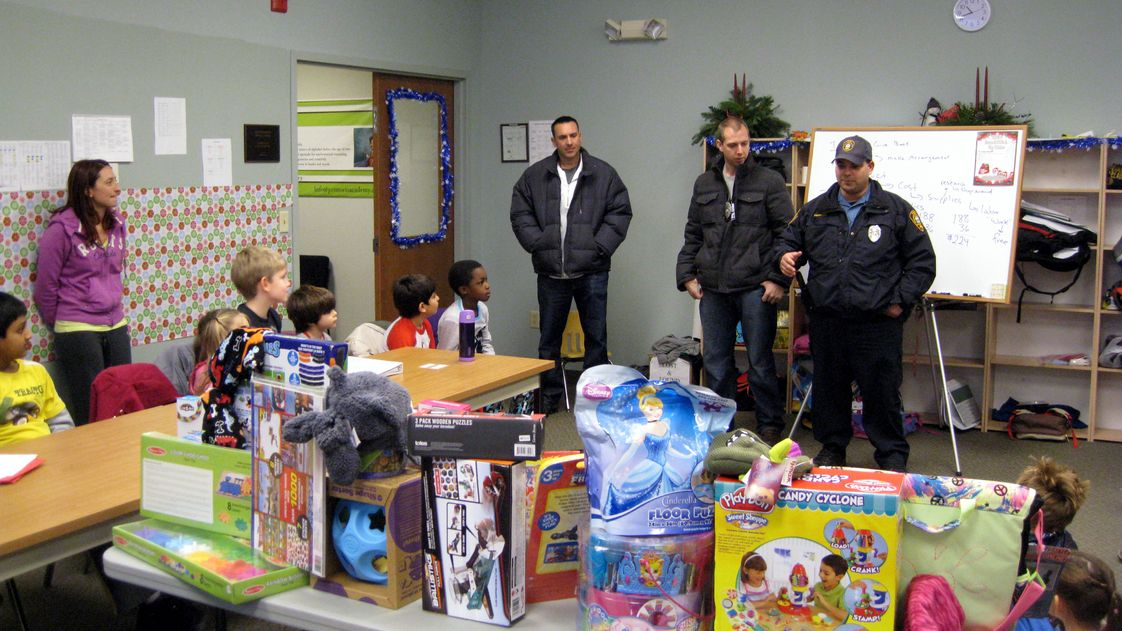 Primoris Academy Photo - In the largest toy drive in Bergen County P.B.A. history, Primoris Academy donated over 50 toys to the Westwood Police Department. Toys were purchased using the net proceeds that Primoris students raised by selling holiday centerpieces they made themselves.