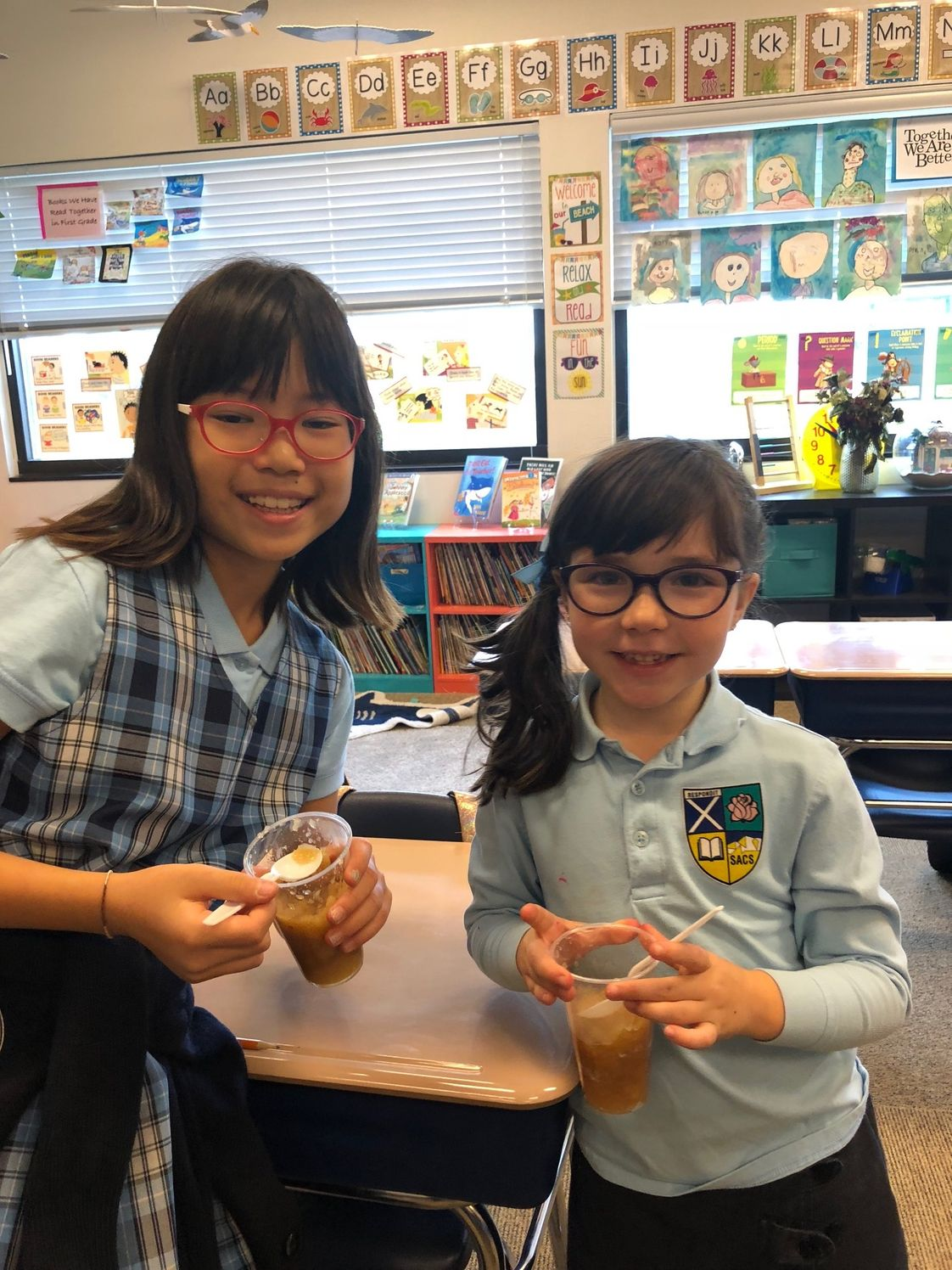 St. Andrew Catholic School Photo - 1st and 4th graders celebrate Johnny Appleseed day by making applesauce!