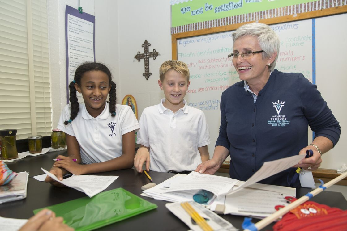 Our Lady Of Victory School Photo - Middle School students enjoy math class with OLV principal Sheila Martinez.
