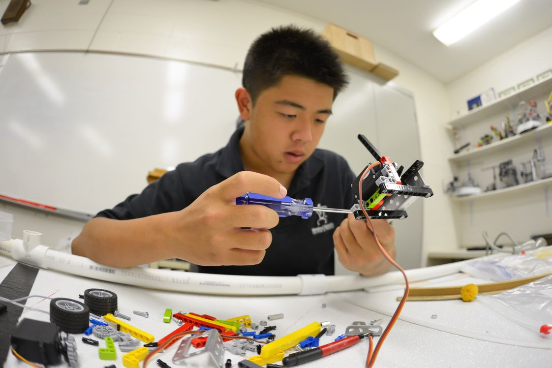 Hanalani Schools Photo - Hanalani has a highly successful robotics program that contributed to two International Championship and 4 Regional Championship Botball teams. Here a student builds a robot from the multitude of parts and tools at his disposal.