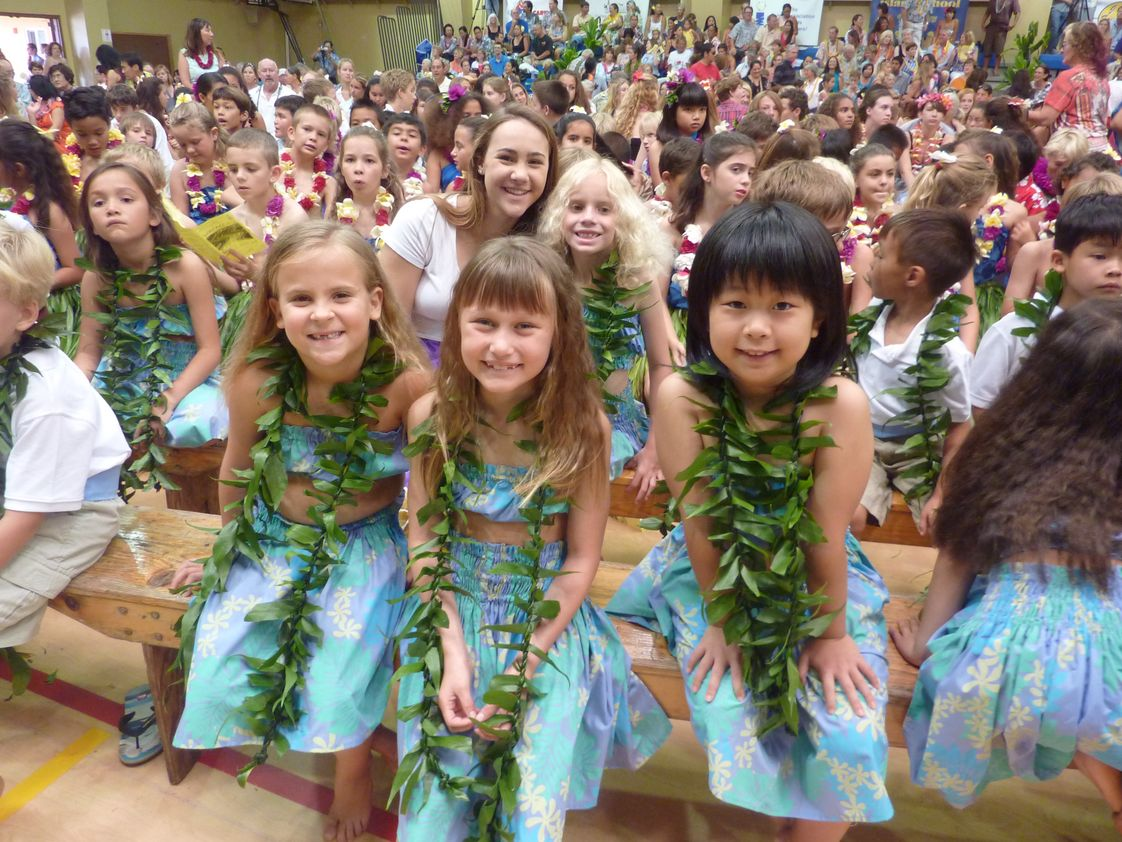 Island School Photo - May Day is Lei Day in Hawai'i. Island School celebrates with an all-school event, followed by a lu'au lunch. These first graders will perform a hula with their class. The entire student body is involved in this special day.