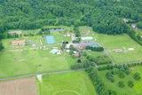 Arial View of Camp Curiosity, The Curiosity Shoppe, The Toddler Center, Curiosity Stables and Curiosity Courts.