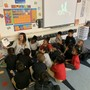 "St. Lawrence Catholic School Photo #10 - Reading by the ""fire"" was such a wonderful break for our kindergartners during a cold winter day!"
