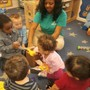 Meyers Road KinderCare Photo - Our toddler class guessing what they will find in the mystery box.