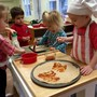 Montessori International Childrens House Photo #4 - The toddlers love making pizza for snack