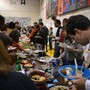 "The GreenMount School Photo #3 - At the theme culminating event for ""Celebrating Culture: We're All from Somehere,"" families dine together on foods from cultures across the globe. Each family researched and brought a dish to share."