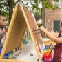 Montessori Parents Coop Photo - Two students enjoying painting outside in the sun!