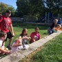 St. John Lutheran School Photo - St. John's 6th-grade dry ice science experiment in front of the outdoor classroom.