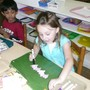 New World Montessori School Photo #6 - Various art lessons are always available for the children to choose.