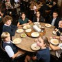 The Rumson Country Day School Photo - Lunch is served family style in our dining room. Each table is thoughtfully comprised of mixed age students and one faculty or staff member.
