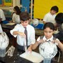 Sacred Heart Of Jesus School Photo - Students explore science with hands-on experiments and project based learning.