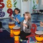 West Hills Montessori School Photo #2 - Active participation in Music instruction is fun at West Hills Montessori!