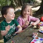 Portland Jewish Academy Photo - PJA's early childhood students creating art in the outdoor classroom.