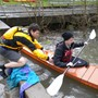 Edison High School Photo #2 - Students work with math teacher Mr. Livesey throughout the year to build two kayaks by hand; here, he helps a student with launching.