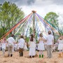 River Valley Waldorf School Photo #4 - Students dance around the maypole during our annual Mayfaire celebration!
