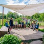 River Valley Waldorf School Photo #6 - Students enjoying gardening class on a beautiful spring day!