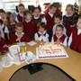 St. Rose Of Lima School Photo - The St. Rose of Lima School Kindergarten celebrated the birthday of baby Jesus with a special cake and song.