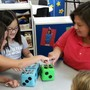 Pinebrook KinderCare Photo #6 - Excellence in Education award winner Ms. Ruby working with school-age children on a math game.