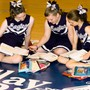 Clay Road Baptist School Photo - CRBS Cheerleaders squeeze in some study time in the gym.
