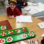 Cascadia School Photo - Using the beautiful Montessori math materials to learn fractions.