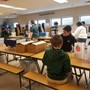 St Patrick's Catholic School Photo #5 - We give back to our community by packing bagged lunches for the Secular Franciscans.