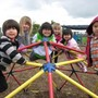 Montessori Learning Center Photo - Primary students enjoy an academic break outside to play.