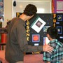 Plumfield Academy Photo - Student projects are enjoyed at the annual Academic Awards.