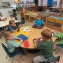 Montessori Childrens House Photo - Children chose individual work in Practical Life area. These activities help build concentration, attention to detail and helps develop small muscle control which are all preparation for math, reading and writing.