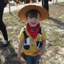 "Flaming Sword Campus Photo - One of our kindergarten students poses for the camera in his Woody Toy Story Outfit. ""There's a snake in my boot !!!"""